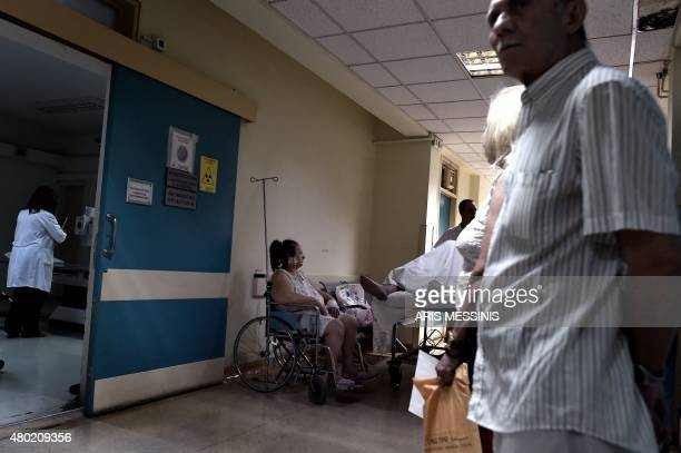 A patient sits in a wheelchair in an Athens hospital on July 8 2015 With expectations of a Greek exit from the eurozone gathering pace health...