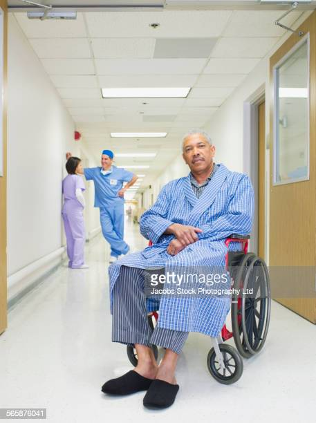 Patient sitting in wheelchair in hospital hallway