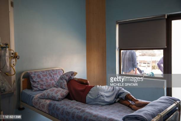 Patient sleeps in his room inside Ward 16, where the drug-resistant tuberculosis patients are housed and treated, on August 5, 2019 at the Sizwe...