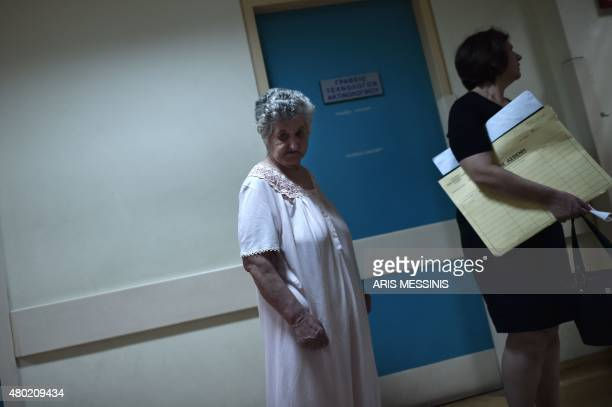 A patient stands in a corridor of an Athens hospital on July 8 2015 With expectations of a Greek exit from the eurozone gathering pace health...