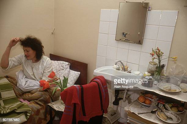A patient suffering from AIDS sits in her bed in a Moscow hospital During the political and economic instability of the late 1980s and early 1990s...