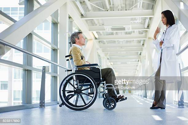 patient talking to doctor - leaning disability stock pictures, royalty-free photos & images