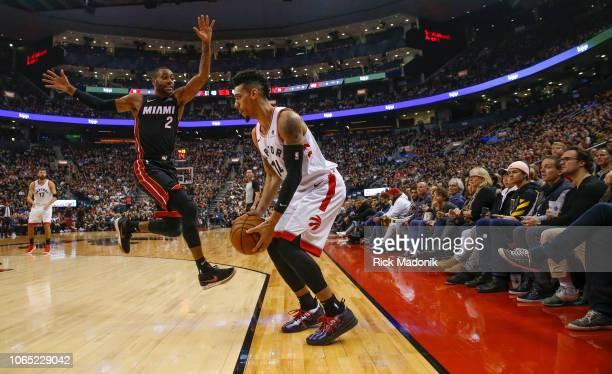 A patient Toronto Raptors guard Danny Green waits as Miami Heat guard Wayne Ellington blows past him and he puts up a successful three pointer...