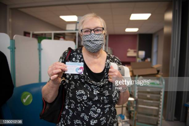 Patient, Trixie Walker shows her Record card after receiving the Pfizer-BioNTech COVID-19 vaccine at the Northern General Hospital, at the start of...