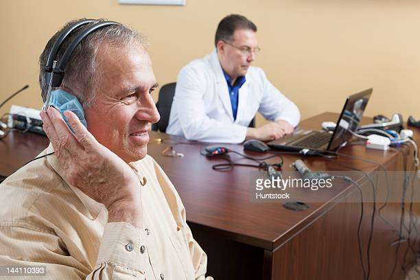 Patient undergoing audiometric evaluation for hearing loss