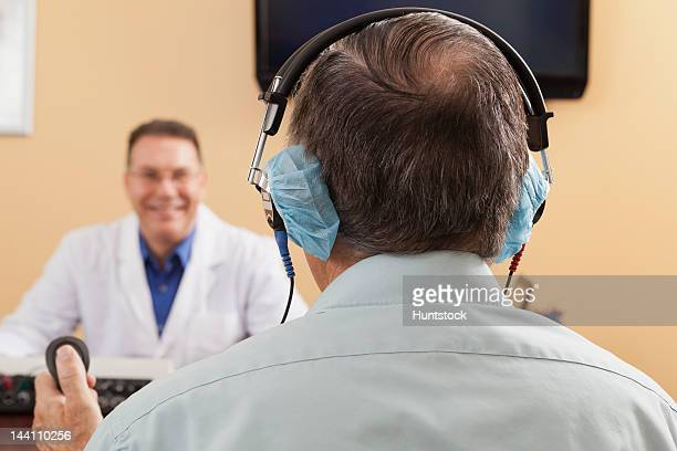 Patient using response button during audiometric evaluation