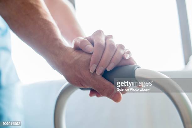 patient using walking frame - weakness stock pictures, royalty-free photos & images