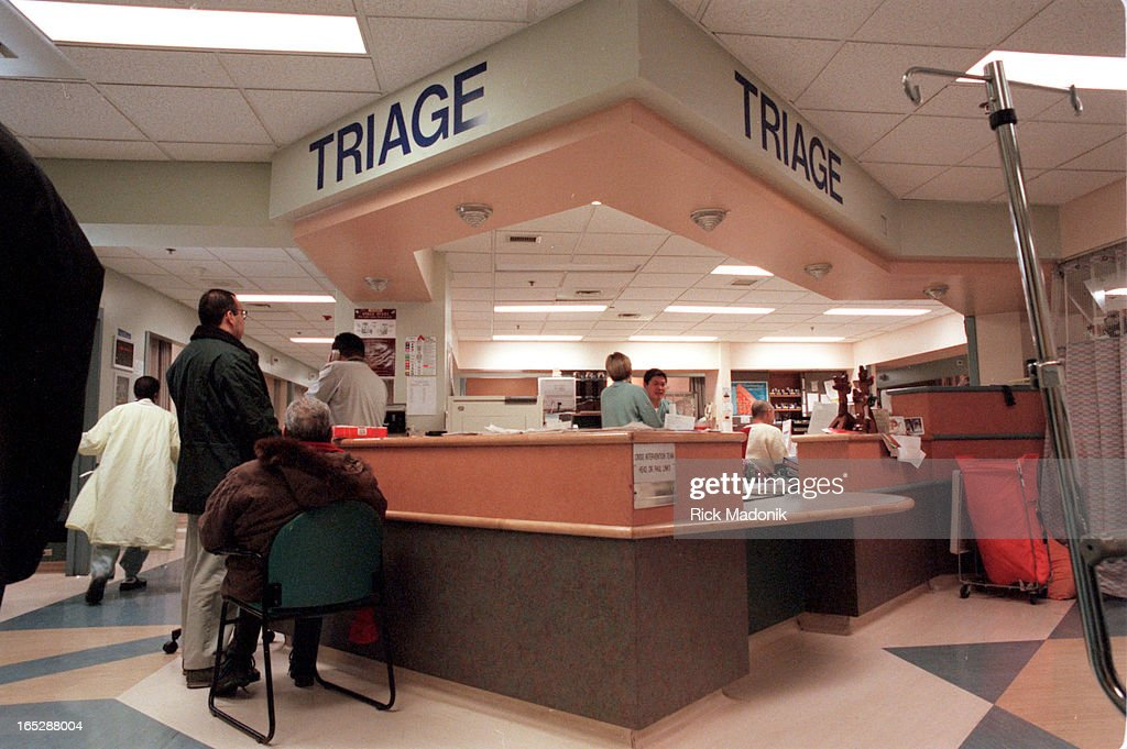 A patient waits at the Triage desk at St. Mikes Hospital ...