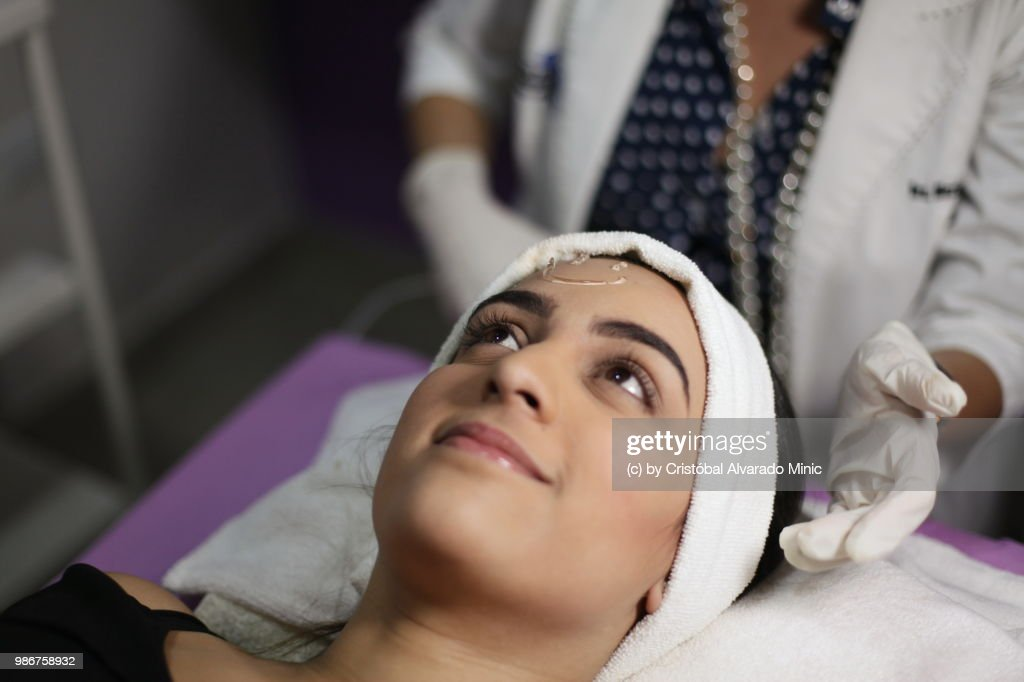 patient waits for aesthetic doctor to perform lightemitting diode