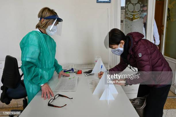 Patient waits to receive the Pfizer-BioNTech COVID-19 vaccine at the Molinette hospital in Turin on December 27, 2020 in Turin, Italy. The European...