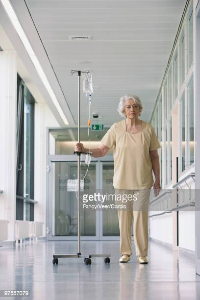 Patient walking in hallway with iv