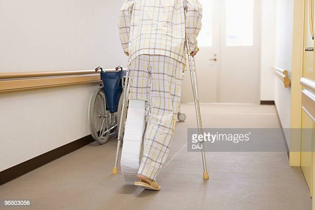 patient walking with crutches in hospital - 骨折 ストックフォトと画像