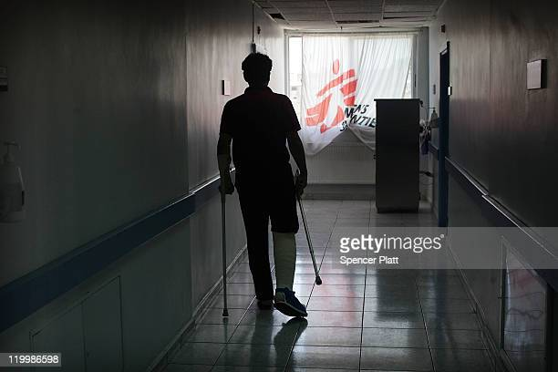 A patient walks down a hall at the Red Crescent Hospital for victims of Iraq violence where Doctors Without Borders/Medecins Sans Frontieres operates...