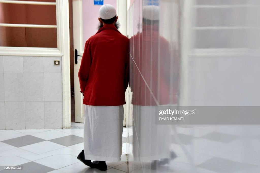 Topshot A Patient Walks In A Hallway At The Drid Hocine