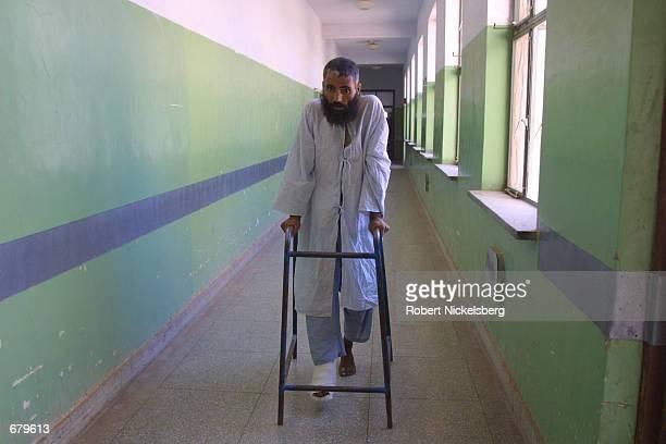 A patient walks through a hallway November 2 2001 of Mirwais Hospital in Kandahar Afghanistan The hospital is critically short of medicines supplies...
