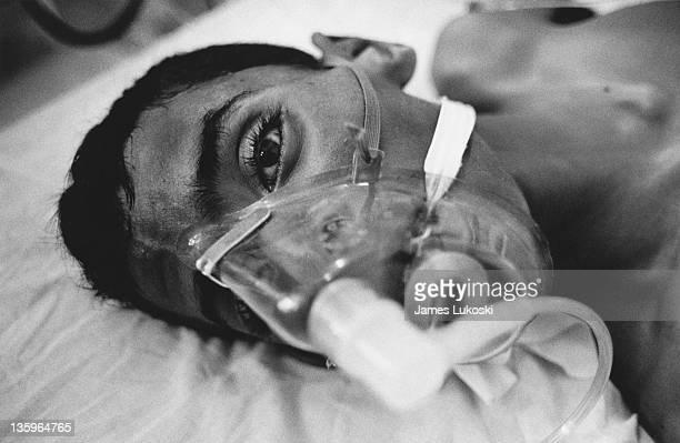 Patient wearing an oxygen mask in hospital during the Israeli-Palestinian conflict, circa 1990.