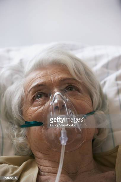 patient wearing respirator - patient on ventilator stock pictures, royalty-free photos & images