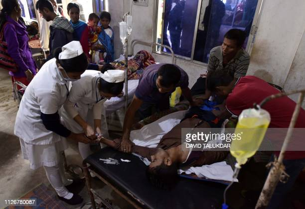 A patient who drank toxic bootleg liquor is treated at Kushal Konwar Civil Hospital in Golaghat district in the northeastern Indian state of Assam on...