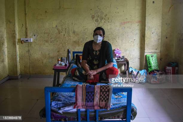 Patient, who has contracted the coronavirus, rests on a bed in a classroom at a school which has been converted into a Covid-19 care facility on June...