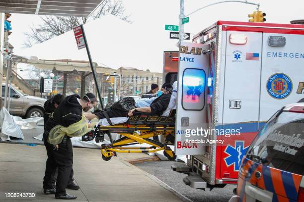 A patient with a face mask is seen at the Maimonides Medical Center in Brooklyn New York United States on March 25 2020 The coronavirusrelated deaths...