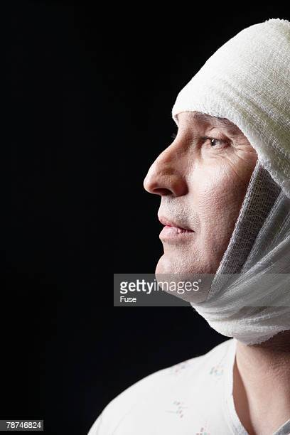 patient with bandaged head - elastic bandage stock photos and pictures