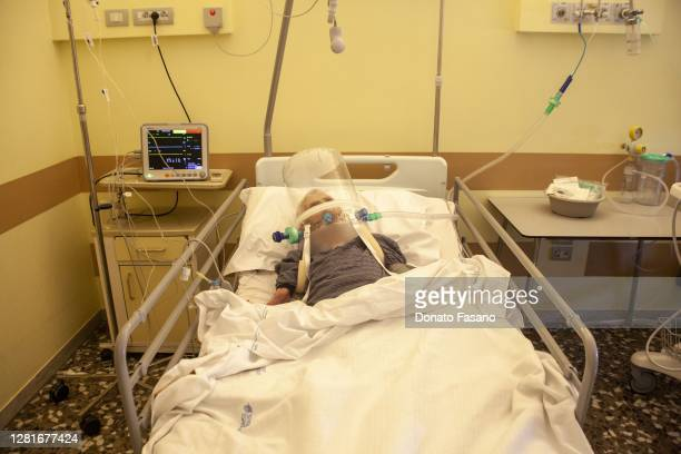 A patient with COVID19 is treated for the condition with the help of a CPAP helmet in hospital on October 22 2020 in Bari Italy New infections from...