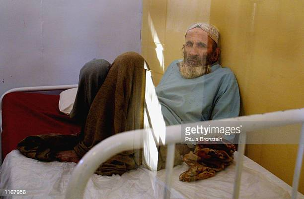 A patient with Crimea Congo Hemorrhagic Fever rests in the isolation ward October 6 2001 of Fatima Jinnah Chest hospital in Quetta So far the fever...