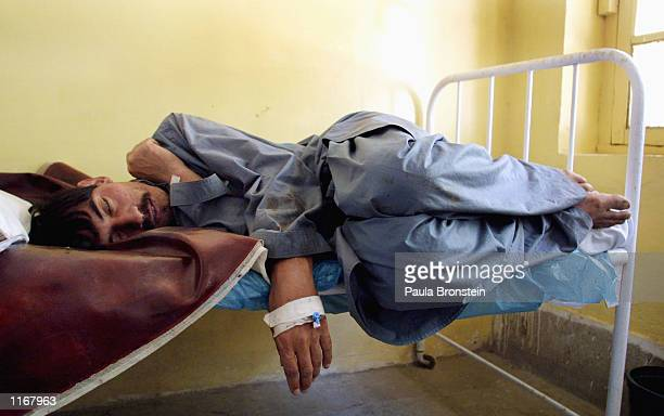 A patient with Crimea Congo Hemorrhagic Fever sleeps in the isolation ward October 6 2001 of Fatima Jinnah Chest hospital in Quetta