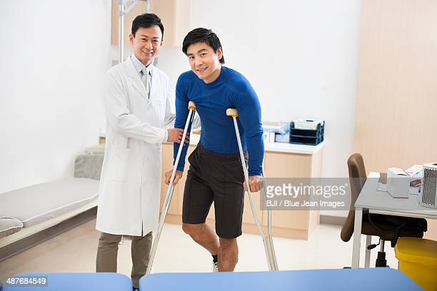 Patient with crutches
