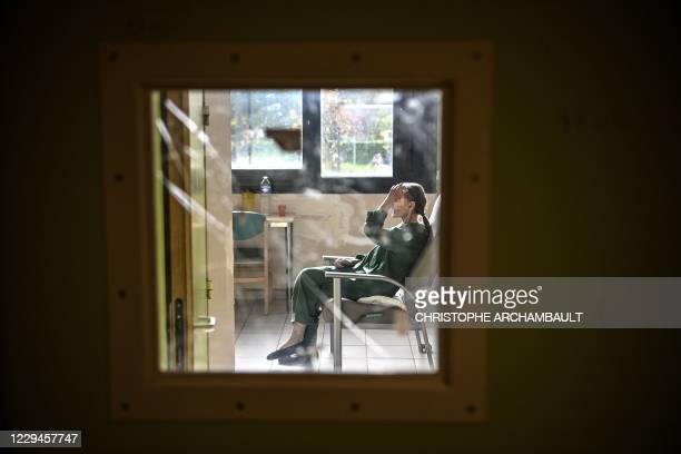 Patient with mental disorders sits on a chair in her room at The Ville-Evrard Psychiatric Hospital in Saint-Denis, north of Paris on November 3,...