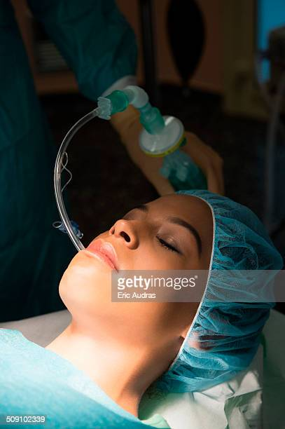 Patient with oxygen mask in an operating room