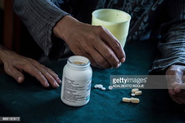 AIDS patient Yohandra takes her medicines at home a former sanatorium for HIV patients in Pinar del Rio province Cuba on April 20 2017 Just over 3800...