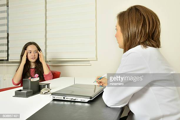 Patient young girl and pediatrician
