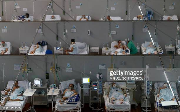 Patients affected by the COVID-19 coronavirus remain at a field hospital set up at a sports gym, in Santo Andre, Sao Paulo state, Brazil, on March...