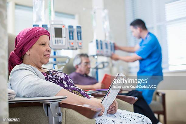 patients and doctor in infusion room - outpatient care stock pictures, royalty-free photos & images