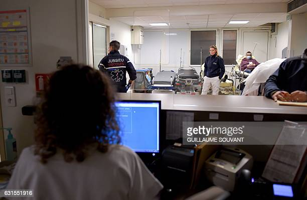 Patients and medical staff wait inside the emergency department of the hospital of Trousseau in Tours on January 12 2017 during a major flu epidemic...
