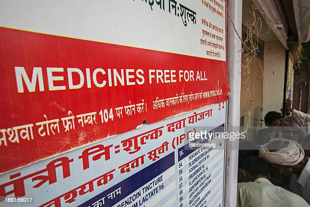Patients and patient's relatives queue up to receive free medicine from a dispensary at the Acharya Tulsi Regional Cancer Treatment Research...