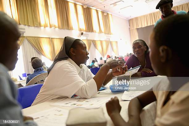 Patients are shown how to fit their hearing aids by Starkey Foundation voluteers at Lesotho Cooperative College on October 10, 2013 in Maseru,...