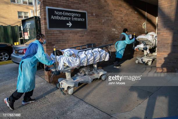 Patients are taken into to the Wakefield Campus of the Montefiore Medical Center on April 06, 2020 in the Bronx borough of New York City. The...