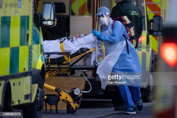Patients arrive in ambulances at the Royal London Hospital, on January 05, 2021 in London, England. The British Prime Minister made a national...