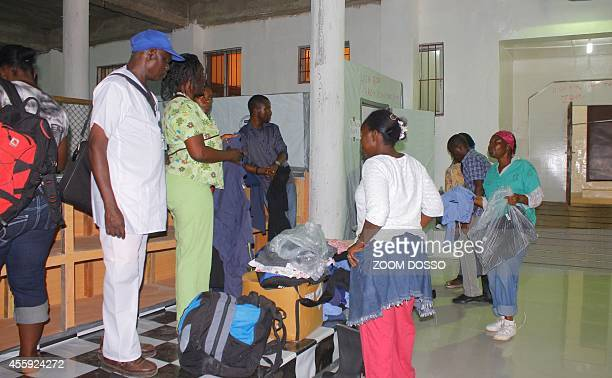 Patients arrive on September 21 2014 at the Island Clinic a new Ebola treatment centre that opened in Monrovia Liberia announced plans on September...