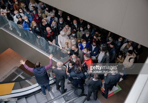 Patients arrive to receive a dose of a Covid-19 vaccine at a vaccination centre in a shopping mall of Belgrade on May 6, 2021. - Serbia's president...