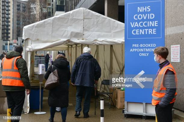 Patients arriving at recently opened NHS Vaccination Centre at Wembley. The site is located near Wembley Stadium, in the Olympic Office Centre. It is...