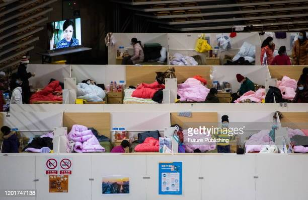 Patients at night in the Fangcang hospital, Wuhan, Hubei Province, China, February 18, 2020.- PHOTOGRAPH BY Costfoto / Barcroft Media