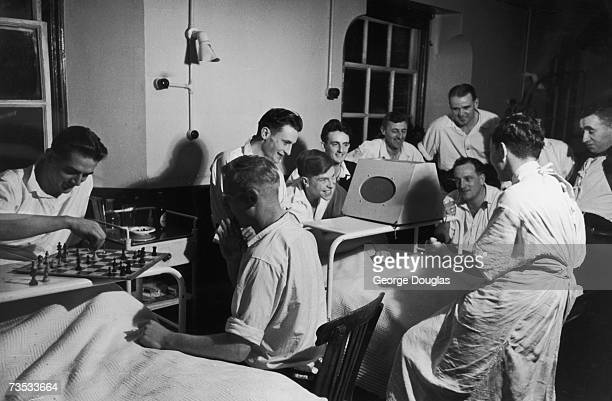 Patients at the Haslar Royal Naval Hospital in Gosport listen to a football match between Portsmouth and Stoke City 15th December 1951 Original...