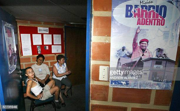 Patients await to be seen by Cuban doctors of the Barrio Adentro programme created by Venezuelan President Hugo Chavez 22 February 2005 in a densely...