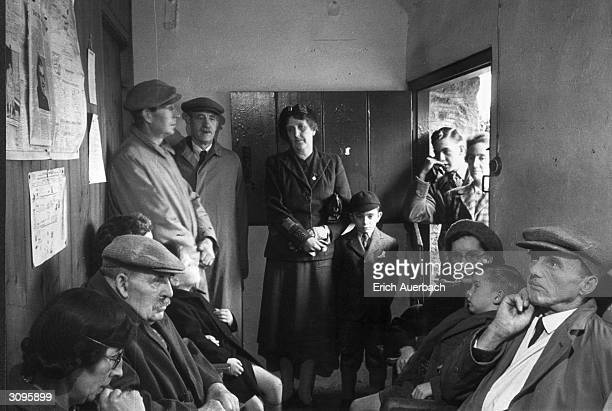 Patients crowding the waiting room of the village surgery at Williton, Somerset.