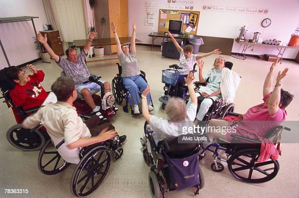 patients exercising in physical therapy - multiple sclerosis stock photos and pictures