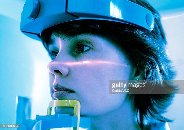 patient's face being scanned - eeg stock pictures, royalty-free photos & images