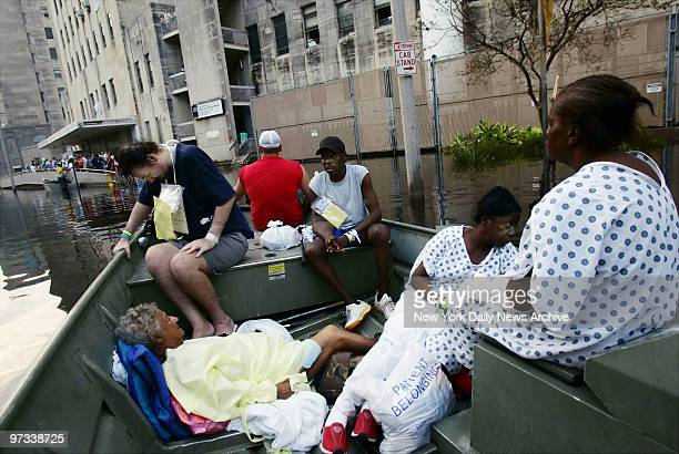 Patients from Charity Hospital float along the flooded streets of downtown New Orleans La as they're returned to the hospital by boat after an...